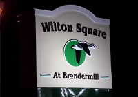 Wilton Square at Brandermill Sign at night